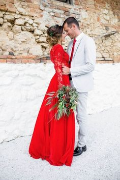 Red Wedding Dress: Could this be you? Do you have the courage to jilt the white dress tradition for a bright red number? Whether or not this choice is for you, you can't help but admire this amazing look. | Gorgeous Ideas for a Red Wedding Palette