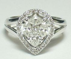 At Countryman's Village Jewelers - Lovely compilation diamond pear with diamond halo ring.. Breath taking in person!