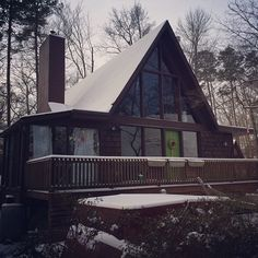 A-Frame with lime green door in winter.