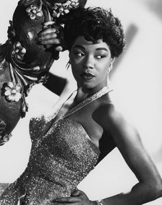 "Sarah Lois Vaughan was an American jazz singer, described by Scott Yanow as having ""one of the most wondrous voices of the 20th century."" Nicknamed ""Sailor"", ""Sassy"" and ""The Divine One"", Sarah Vaughan was a Grammy Award winner."