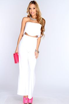 Get the hottest two piece outfit here! Just check out this one of a kind style, paired with pumps or single sole heels you will sure be in style. Featuring a cropped tube top with a pleated flap detail, high waist gaucho pants, and fitted. 96% Polyester 4% Spandex.