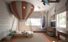 The hot air balloon-inspired look is straight out of a storybook and is sure to be the source of many sweet dreams. The airborne theme is carried through the rest of the room as well with a hanging biplane and a dangling hammock chair for the ultimate in coziness.