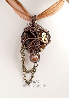 OOAK Brown and amber yellow steampunk wire wrapped pendant. €40,00, via Etsy. $51
