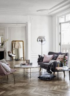 Blush pink, grey, and white interior with brass accents