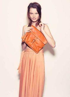 Orange / Lovers & Collaborators pants. Phillip Lim clutch. via Russh Magazine.