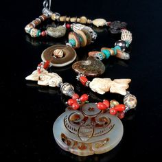 STATEMENT NECKLACE by Liz Wolter / Customize by sparepartsjewelry; Hand Carved Vintage Jade, Turquoise Disks and Chunks, Oxidized Tibetan Silver, Water Buffalo Horn, Batik Bone Beads, Hand carved Koi Fish Bone Amuletes, African Trade Beads, Fossilized Ammonite shell fossil