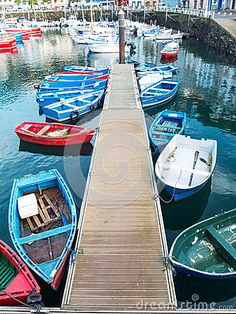 LUARCA, SPAIN - DECEMBER 4, 2016: Colorful boats at the fish market pier in Luarca, Spain.