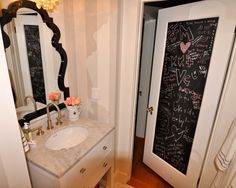 Door is so cool.  Wonder If you could just use piece of thin plywood, paint with chalkboard paint and adhere to door with 3 m Velcro strips.  Then easy to remove!  Hmmmmmm?