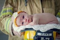 Sweet picture of fire fighter dad and baby photo shoot. this may be a MUST and include big brother kayden in it too;)