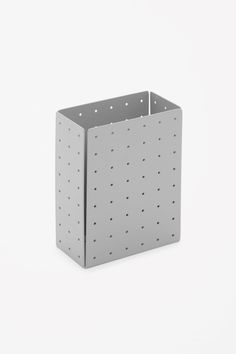 Made from perforated metal in a simple geometric shape, this storage box is designed to keep your desk tidy.