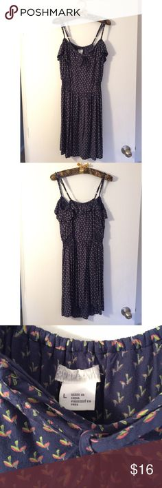 Cooperative Urban Outfitters Floral Dress | Size L Adorable blue dress with floral design in size large by Cooperative. Adjustable spaghetti straps and ruffle along hemline. Riches least waist and keyhole at neckline. Dress falls at knee. Urban Outfitters Dresses