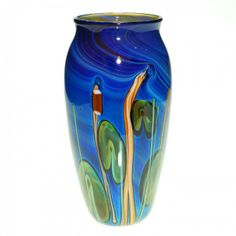 Early Satava vase displaying cattails, leaf spikes and lily pads before a water backdrop. Dated 1986