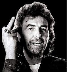 GEORGE HARRISON SHOWS HIS RING FINGER...