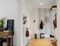 by Swedish interiors firm, Alvhem // lovely use of wallpaper.