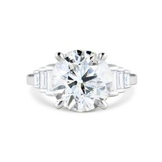 Bespoke brilliant-cut diamond and tapered baguette-cut diamond ring mounted in platinum.