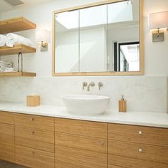 Warm natural wood furniture can still be modern.  Contemporary Bathroom Chocolate Design, Pictures, Remodel, Decor and Ideas