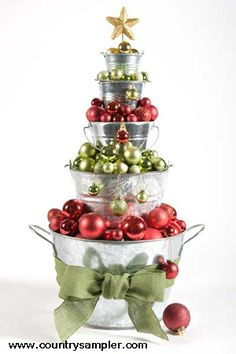 Several shiny buckets in graduating sizes and a grouping of sparkly holiday ball ornaments make this clever Christmas tree! Discover more tree ideas: http://www.countrysampler.com/decorating/hints/trees-that-please?limit=10&offset=0&source=Pinterest  Find more holiday ideas in our November 2013 issue: http://www.samplermagazines.com/October_November_2013_Country_Sampler_Pre_sale_p/cn13b001a.htm?source=Pinterest