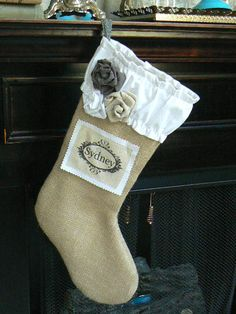 Burlap  Christmas Stocking   Shabby Chic with Ruffled White Cotton Cuff and Custom Name Tag. $29.50, via Etsy.