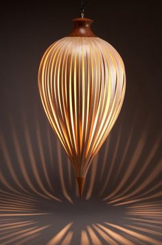 Plumb Pendant Light by Peter Pierobon: Made of yellow cedar slats lit with a low voltage halogen light.