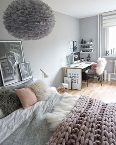 Nothing says cozy quite like layers and textures. Love the knit blanket and furry pillows