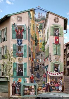 """Patrick Commecy's Fake Facade: A mural in the town of Le Puy-en-Velay which is titled """"Renaissance."""" - photo by A. Fresco, via Amazng Facts;  The clever French artist and his team of muralists have created eye-catching scenes around France by transforming dull and boring facades into a place full of life."""