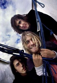 August 23rd, 1991 - Nirvana photographed outside at the Reading Festival by photographer Steve Gullick.