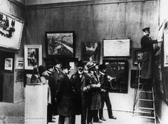The photograph below shows members of the Berlin Secession's steering committee preparing for a 1904 exhibition. It includes from (left to right): Willy Döhring, Bruno Cassirer, Otto Engel, Max Liebermann, Walter Leistikow, Curt Herrmann, and Fritz Klimsch, as well as the unknown man on the ladder.