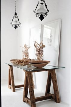 The trestle table with glass top, was found at On Site Gallery