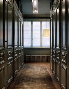 A uniformly earth-toned entry simplifies a Paris apartment's cabinet-lined hall. Design by Frédéric Sicard. Photo by Hervé Goluza via Côté Maison.