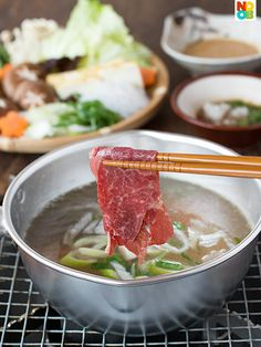 Shabu Shabu Recipe Shabu Shabu (しゃぶしゃぶ) is a Japanese hot-pot meal where very thin slices of beef are momentarily (few seconds) cooked in hot broth. It is the savoury cousin of the sweeter sukiyaki. Hot Pot, Shabu Shabu Recipe, Fondue, Sushi, Asian Soup, Asian Cooking, Asian Recipes, Asian Foods, Top Recipes