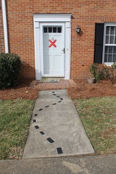 Creative idea for a pirate birthday party: Decorate the walkway to the front door like a treasure map.