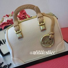 3d Michael Kors purse cake by Christina Pagan & Yesenia Figueroa  Feeds about 25 people.  Find us:  Facebook.com/alittleslice1 & Instagram @Tracey Fox Edgell
