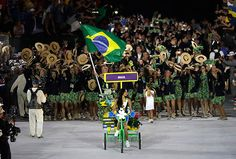 Yane Marques carries the flag of Brazil during the opening ceremony for the 2016 Summer Olympics in Rio de Janeiro, Brazil, Friday, Aug. 5, 2016.