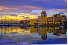 GRUISSAN France periwinkle blue and blush sky and water..yellow buildings..