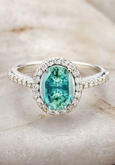 Gorgeous! A teal sapphire diamond ring. I think I would prefer something paler, like aquamarine, but still so pretty.
