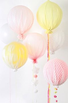Upholstered Balloons: blow up your balloons, drape a piece of sheer fabric over the balloon and use a rubber band to secure the fabric to the tied end