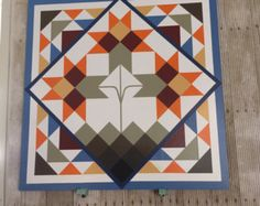 Barn quilt in aqua, yellow, red, and green. This barn quilt would not only look beautiful on a barn but also on your garage or shed! The blues and greens in this barn quilt is perfect for a beach house! Wood is excellent grade mdf plywood for a smooth finish. Paint is exterior paint suited for outdoor use. Can be made to order in your colors. This is a custom order piece so please allow up to 2 weeks before delivery. Size is 2 x 2.