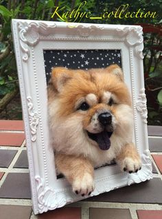 Needle wool felt of a baby Chow Chow's head on by KathycCollection