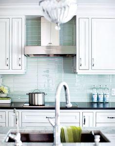 stacked glass tile backsplash in kitchen by Aly Velji