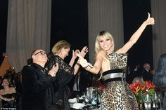 Thumbs up! Heidi put on an animated display as she toasted to another successful fundraise...