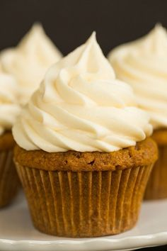 Pumpkin Cupcakes with Cream Cheese Frosting - A perfect fall treat! | browneyedbaker.com