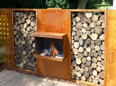 Corten steel patio fire place with wood storage | open haard set met houtopslag by abk-outdoor.com