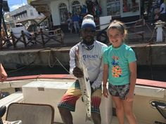 Happy Little Lady with catch aboard Legacy Barbados. Fishing Charters, Barbados, Lady