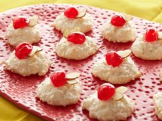 Almond Snowballs from Rachael Ray (coconut macaroons garnished with candied cherries and sliced almonds)