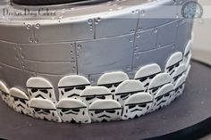 Stormtroopers on Star Wars cake - DYING over this idea!!  Could make them all up way ahead of time (no dye!) Spray that layer silver.  Death star on top of that layer (this one is the 2nd layer then) (bottom layer is Jedi, maybe? or at least dark w/ stars) (or flipped... not sure yet)