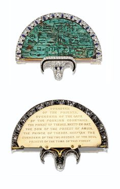 EGYPTIAN-REVIVAL JEWELED FAN BROOCH, CARTIER, LONDON, 1923 with view of reverse. Composed of an Egyptian glazed steatite plaque of semicircular shape, circa 600 B.C., inscribed with hieroglyphs, set with onyx,  diamonds, enamel and sapphires, platinum and gold. Signed Cartier.