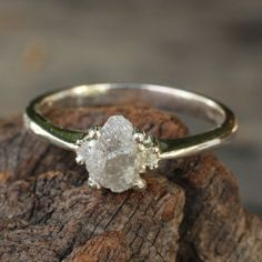 Rough white diamond engagement ring in by MetalStudioThailand, $148.00 I LOVE ALL OF THEIR RAW DIAMOND RINGS! i'd much rather have white gold band diamonds