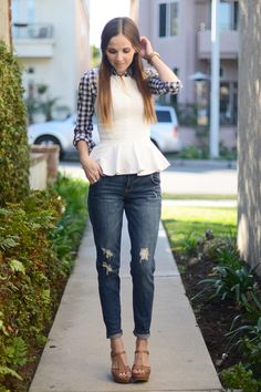 Blue gingham button up layered under a white peplum with jean skinnies and wedge sandals