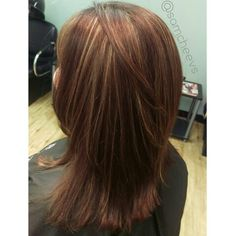 Red hair with blonde highlights to the root, medium length haircut with layers