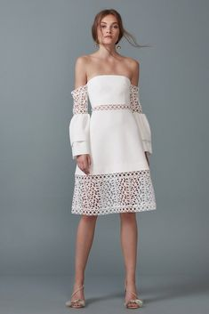 Uplifted Dress. A stunning midi length dress by Keepsake the Label. An off shoulder style featuring two tier flared sleeves and lace panelling. #bridalshower #bachelorette #engagement #whiterunway